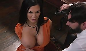 Raven-haired pornstar upon huge tits receives drilled alongside the ass